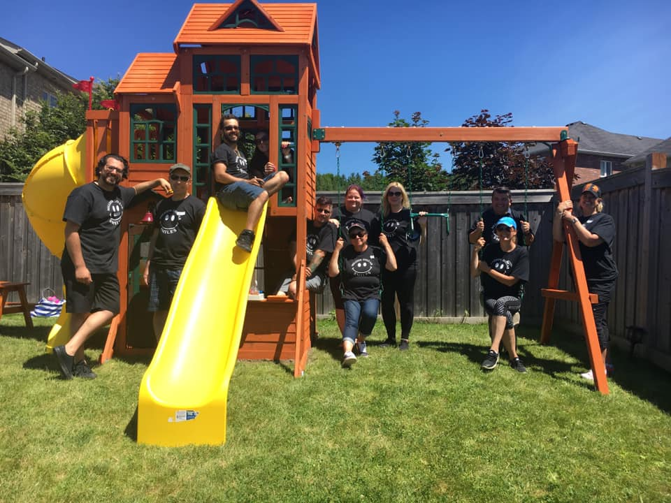 Smiles All Around After Vince's Team Builds Multi-Station Playground